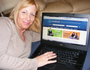 Jane lying next to a lap top showing the Evenbreak website