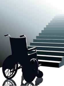 Empty wheelchair at the bottom of a flight of stairs