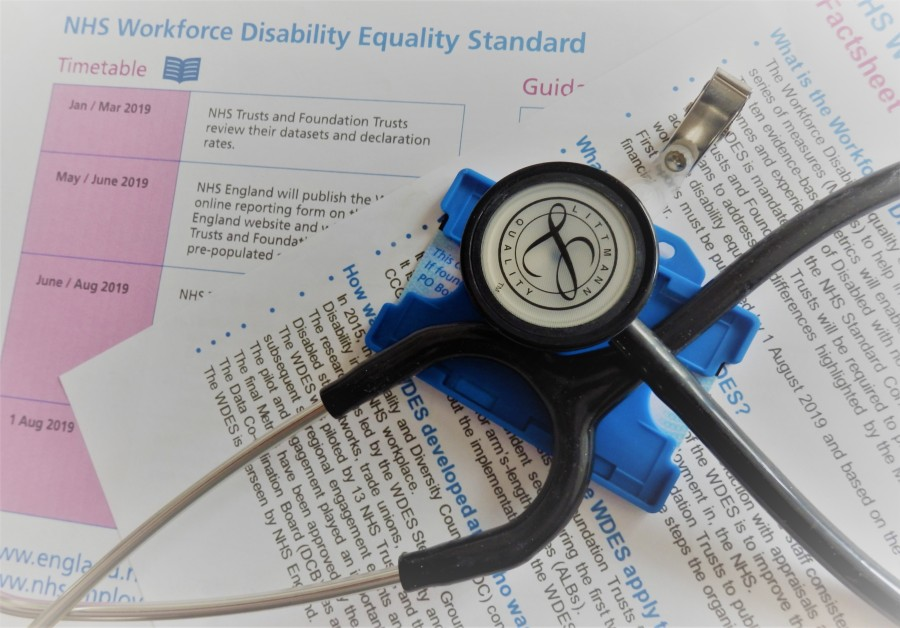 Image shows a stethoscope on top of NHS documents