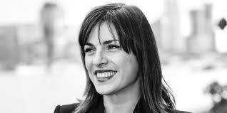 Black and white photo of Maria, smiling.